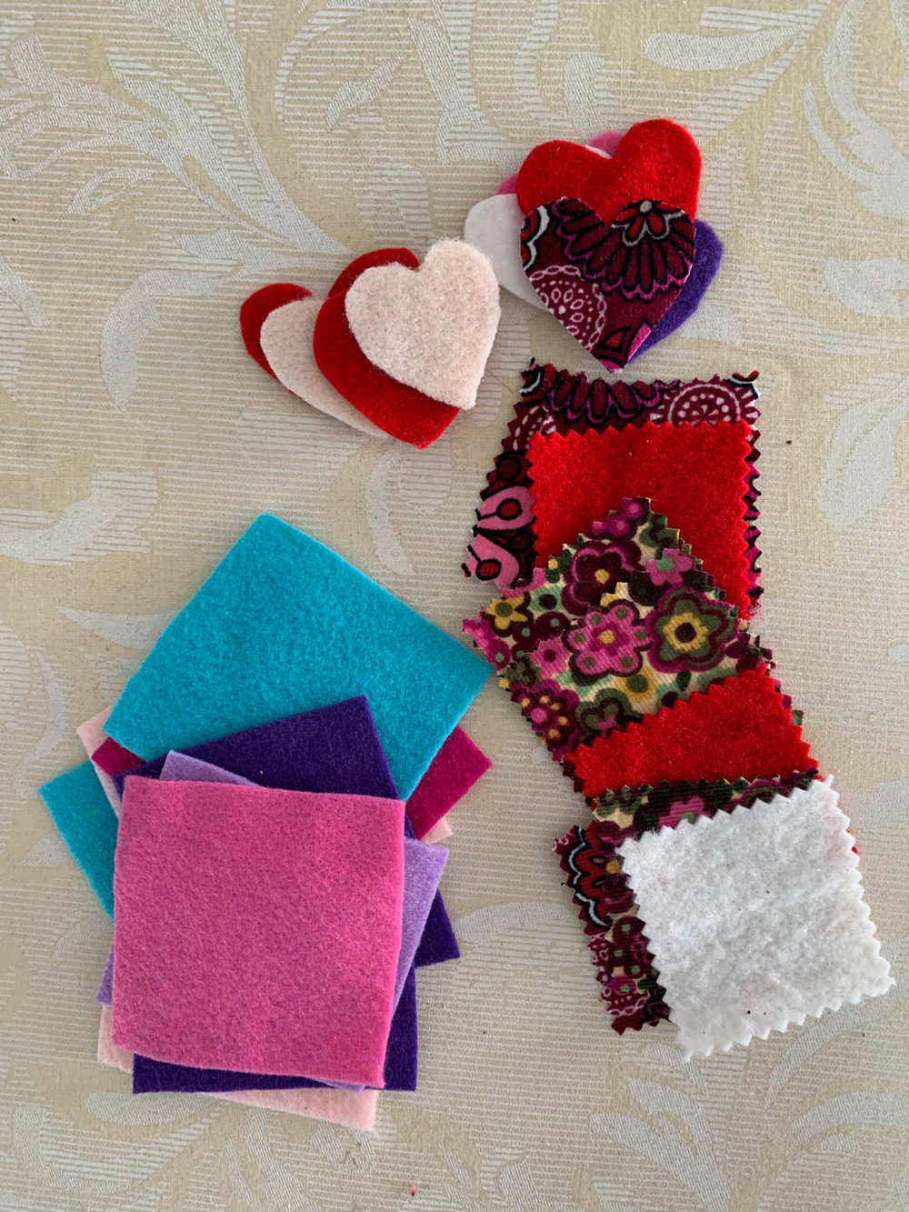 Felt squares and heart shapes with pinked felt and fabric squares