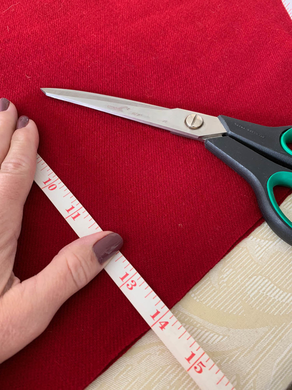 measuring tape and scissors with red felt fabric