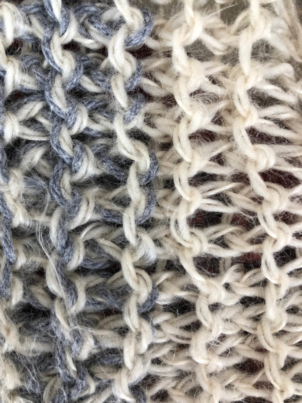 close up of hand knitted garter stitch in winter white yarns