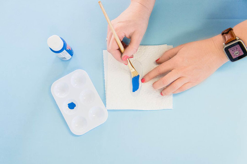 painting cooled hot glue shapes with acrylic blue paint
