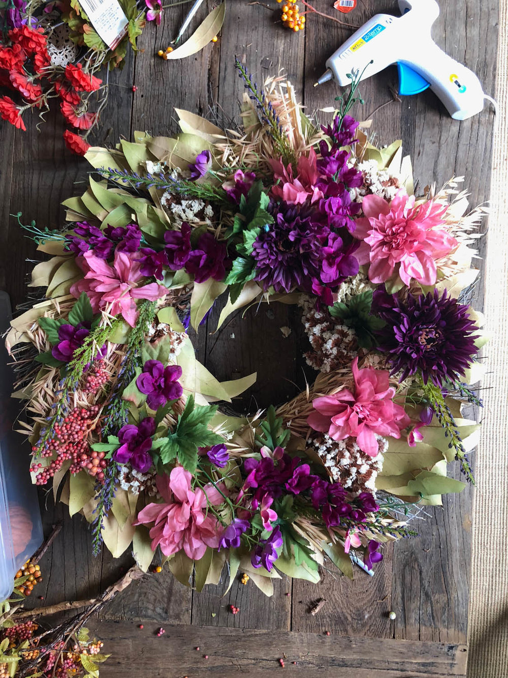 silk flowers glue gun and finished upcycled DIY spring wreath
