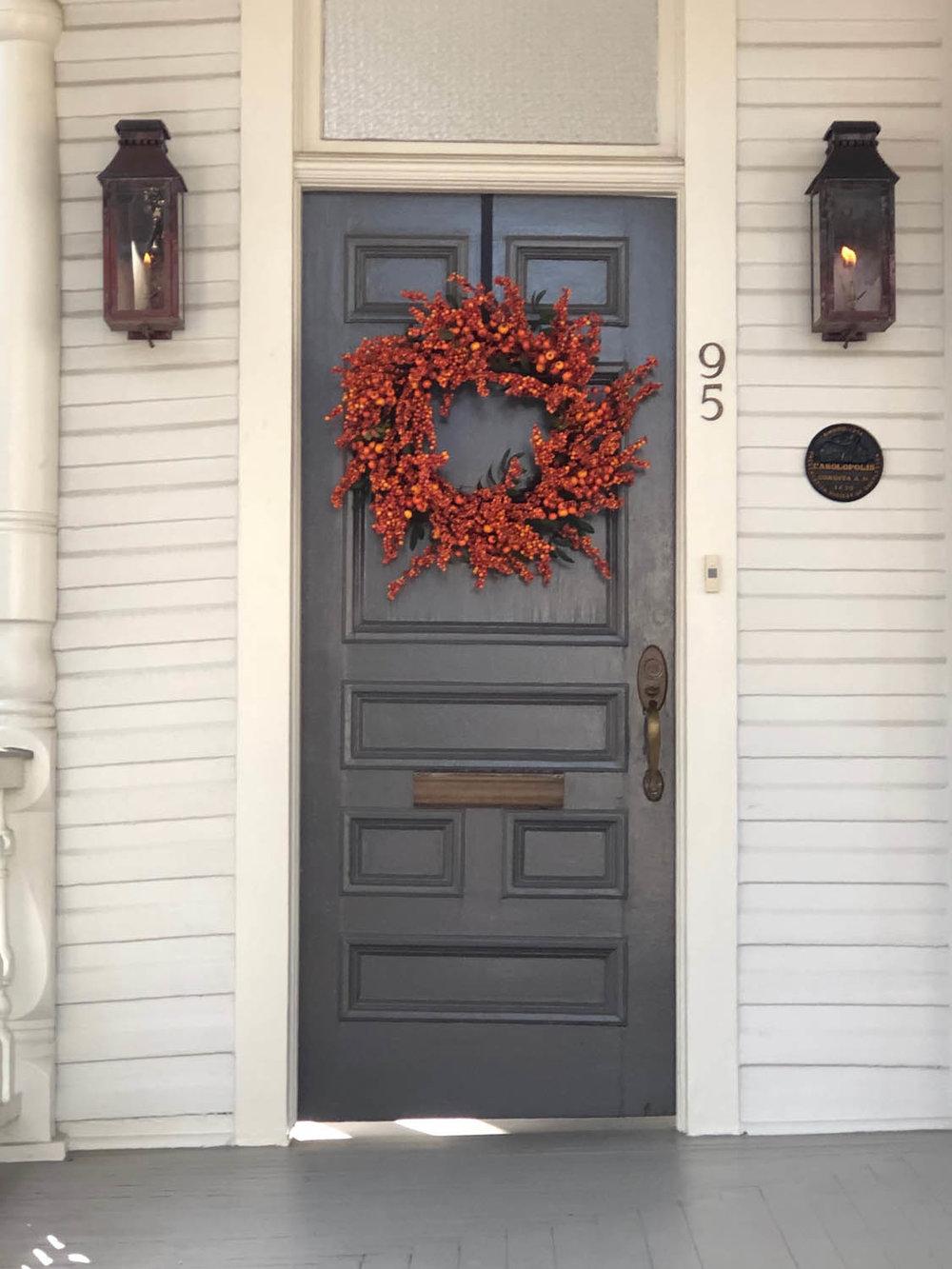 blue door with berry wreath
