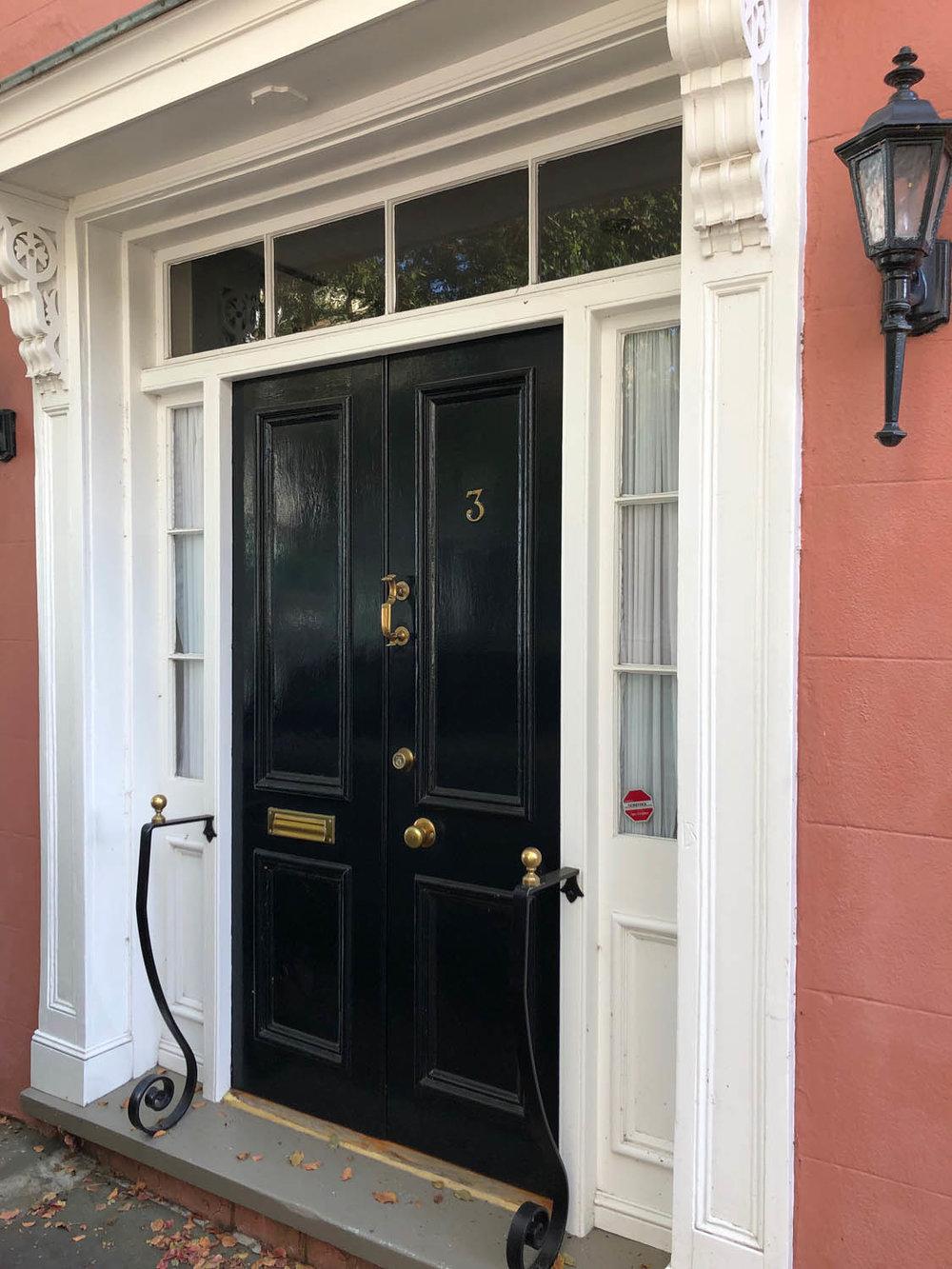 black double doors in Charleston Battery