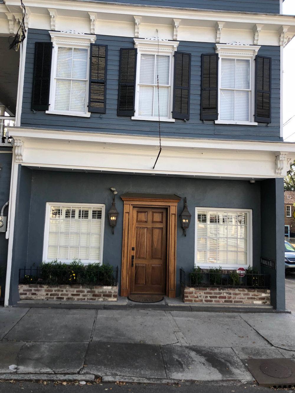 blue Charleston house with wood door