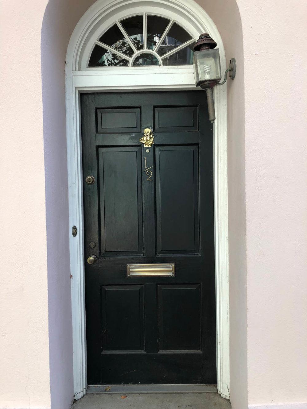 elegant stately black door in Charleston