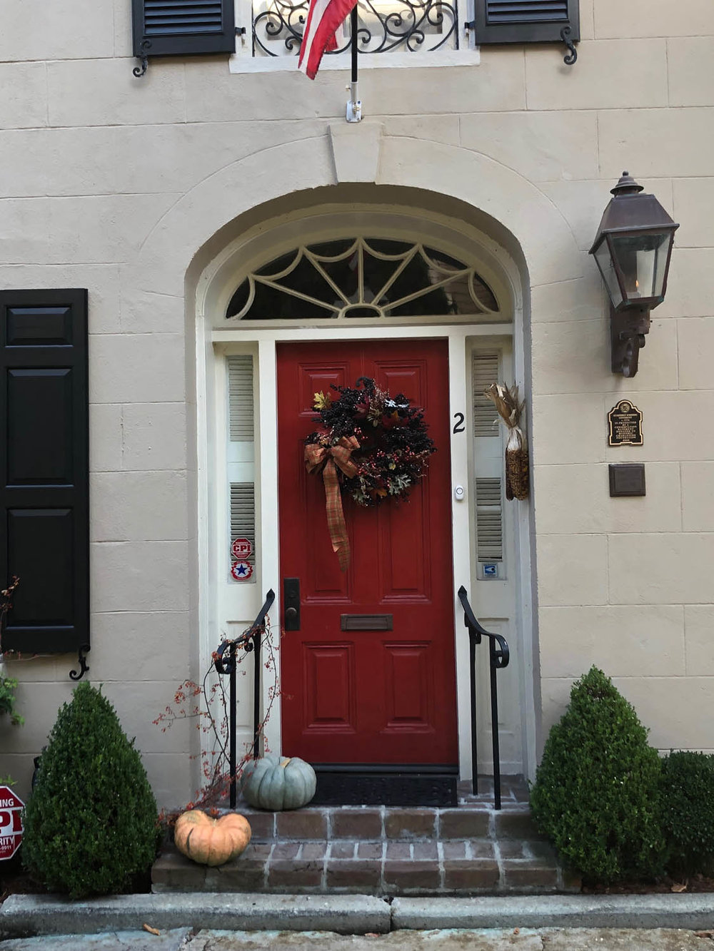red door on stately home in Charleston