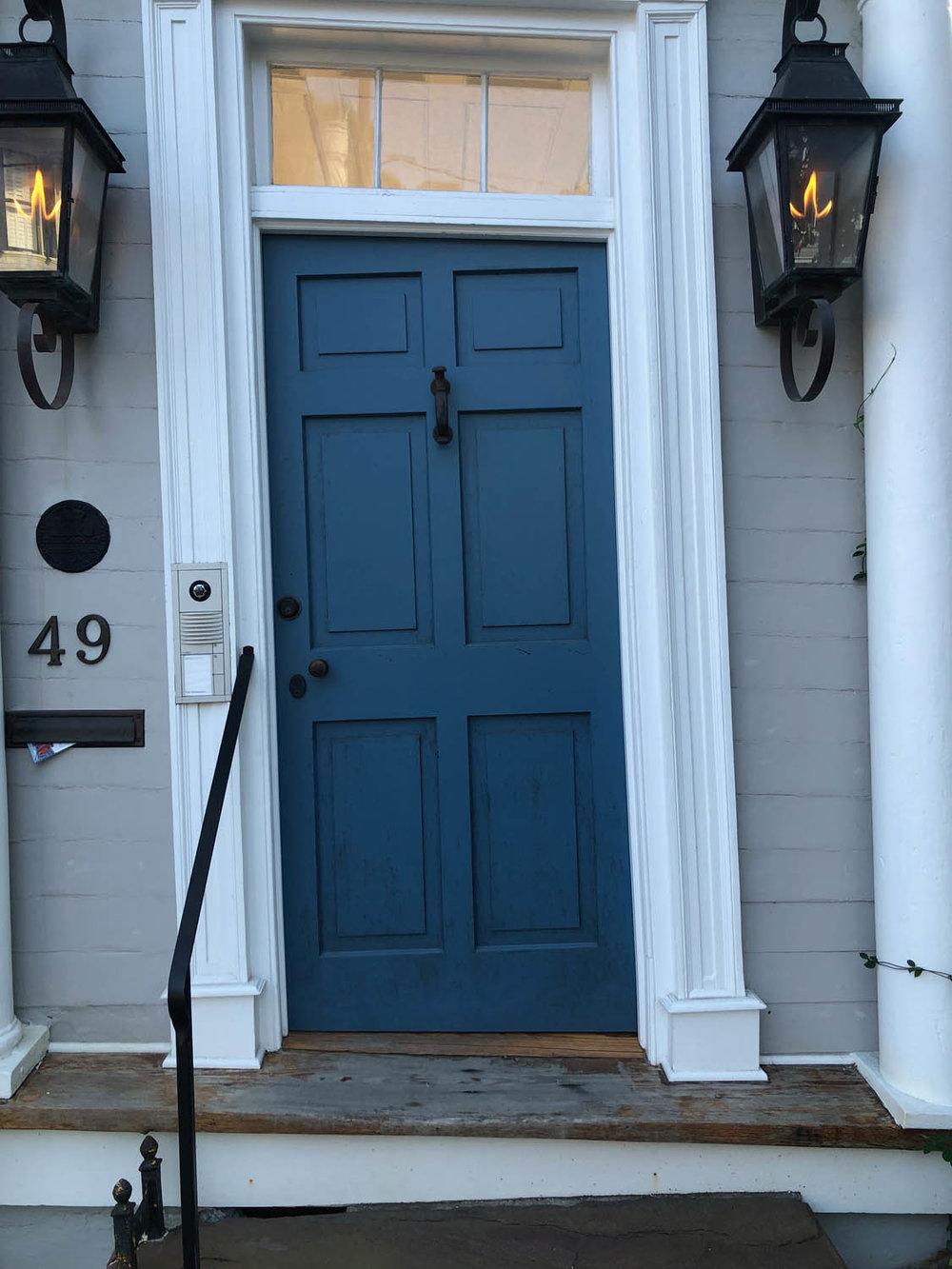 blue exterior door on gray Charleston home