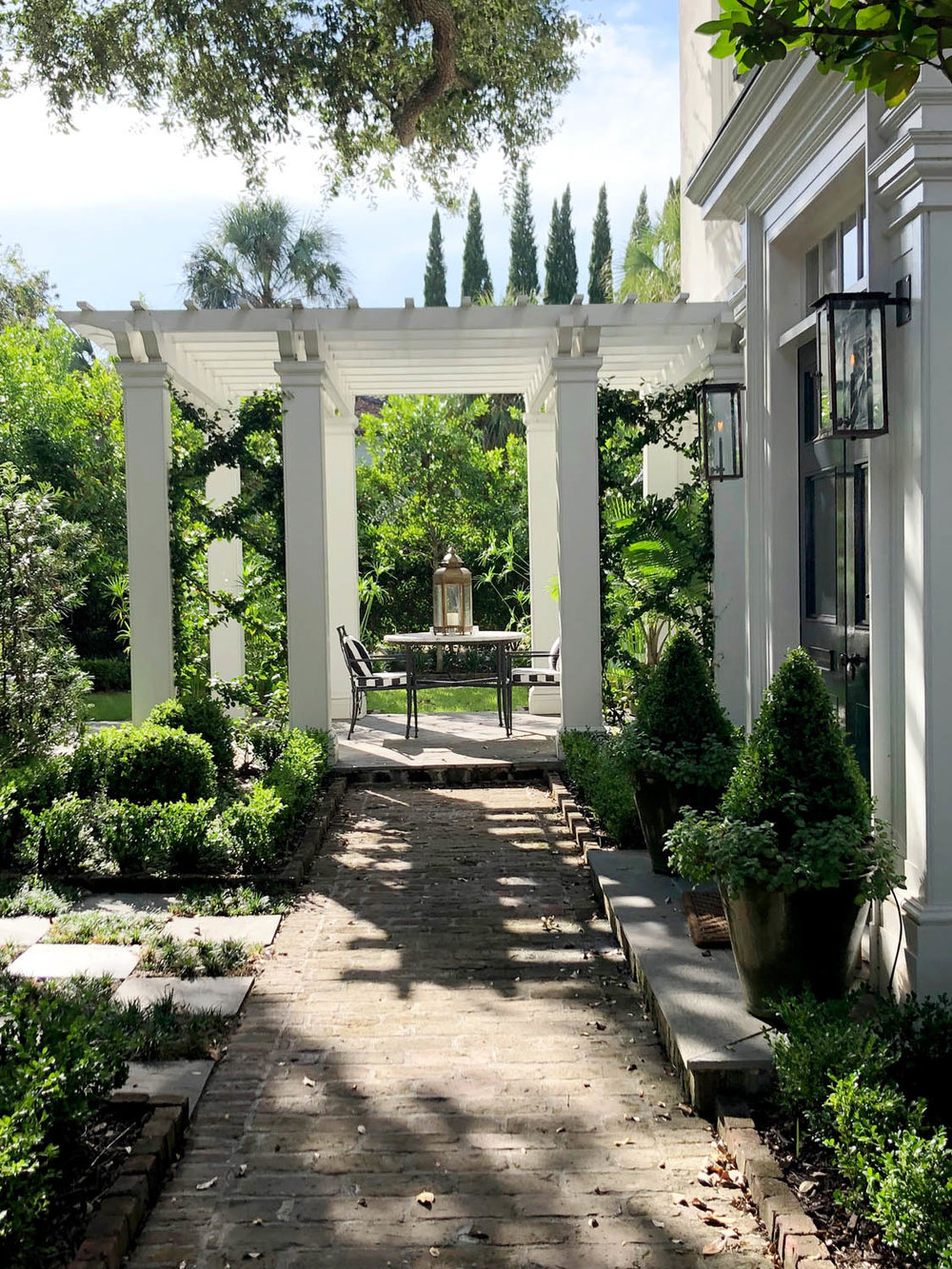 beautiful patio with white pillars