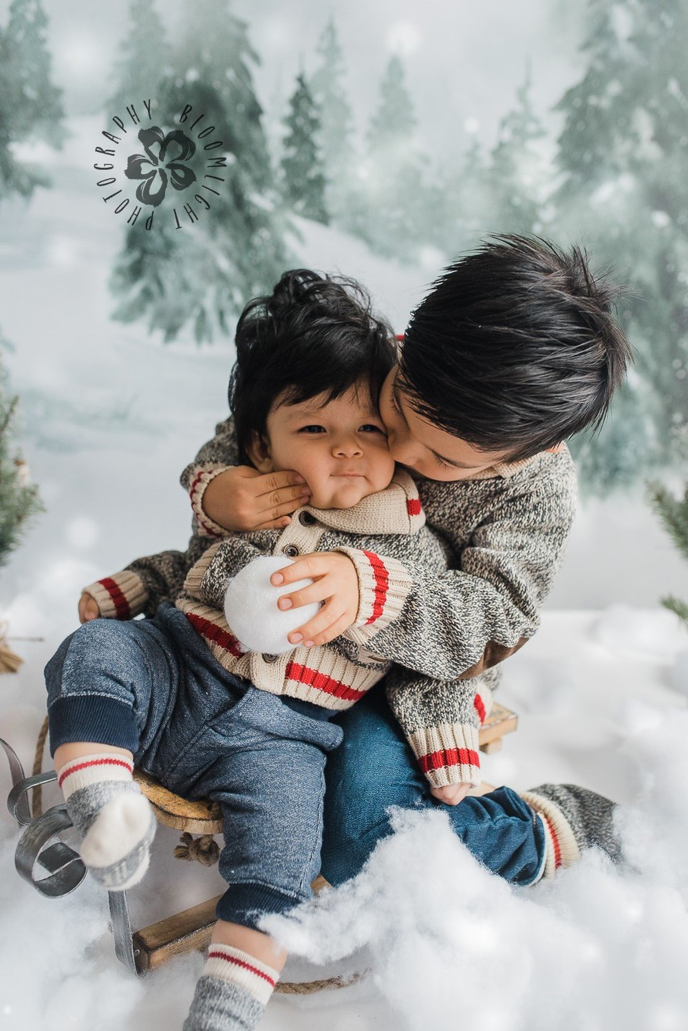 Big brother kissing his little brother in Holiday mini session