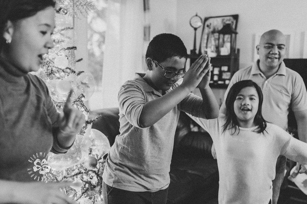 Happy-family-photo-dancing-celebrating-Christmas-at-home-Toronto (1).jpg
