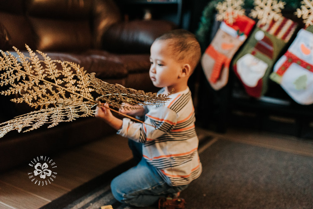 Little-baby-boy-home-playing-Christmas-props-home-Scarbrough-family-Photographer.jpg
