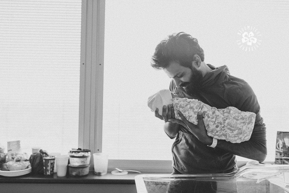 New dad enjoying his time with newborn at Mount Sinai Hospital, Toronto