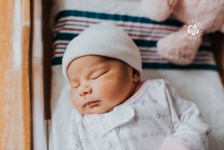 Chubby newborn in hospital bassinet sleeping photo in north york toronto