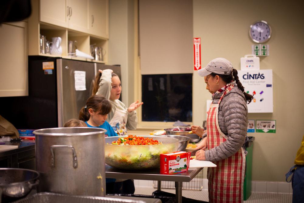 Mika, Esther, Rose _ Naomi making salad _ apple crumble.jpg