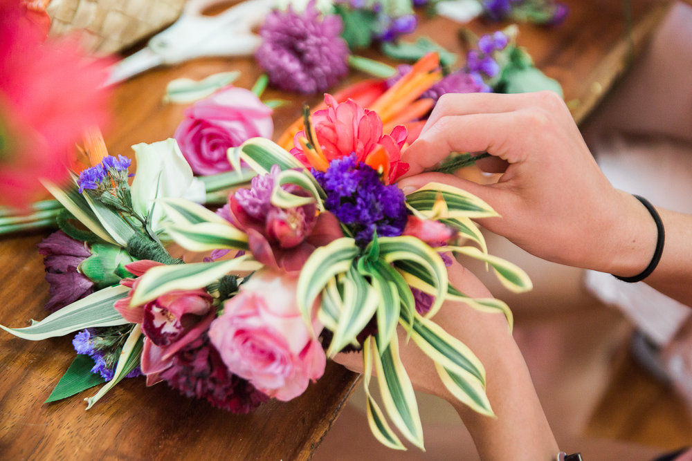 Workshop participants can choose from a wide assortment of photos to create their floral crown.