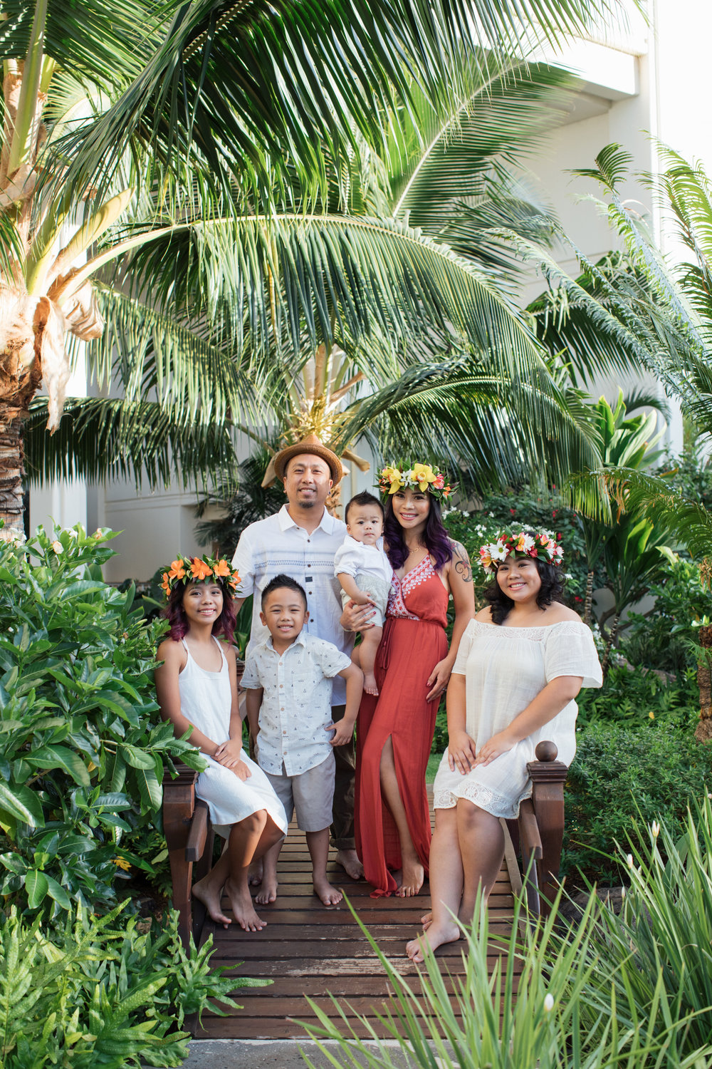 Bright coral colors added a pop to this family's outfits for their photography session!