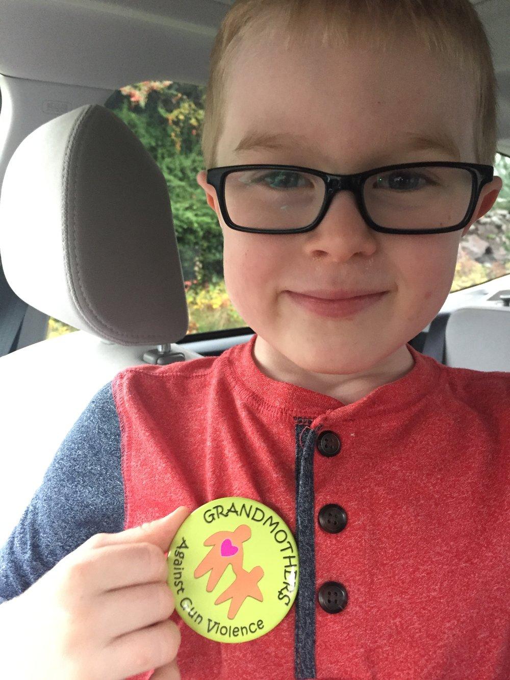 A grandchild wears his button