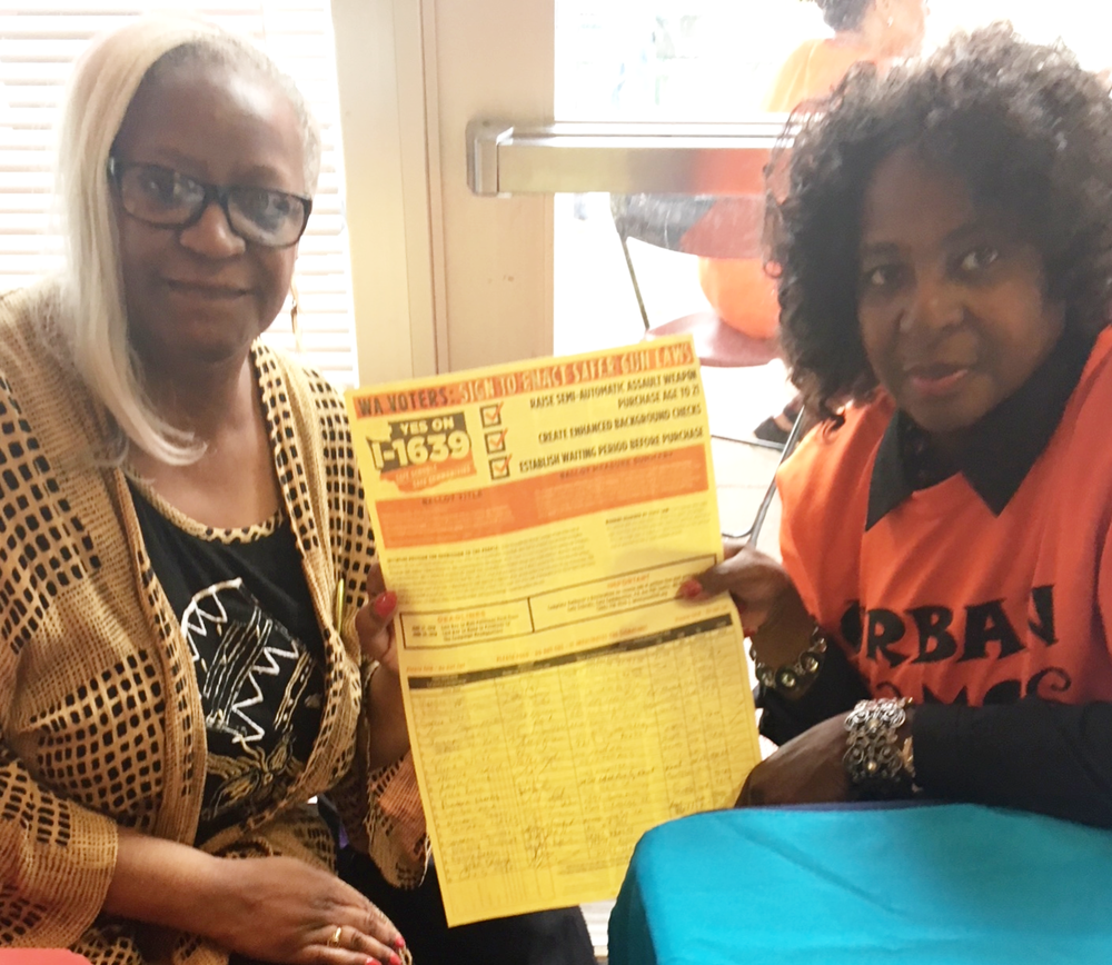 Sarah Dean and Winoona Hollins-Hauge gathering signatures for I-1639