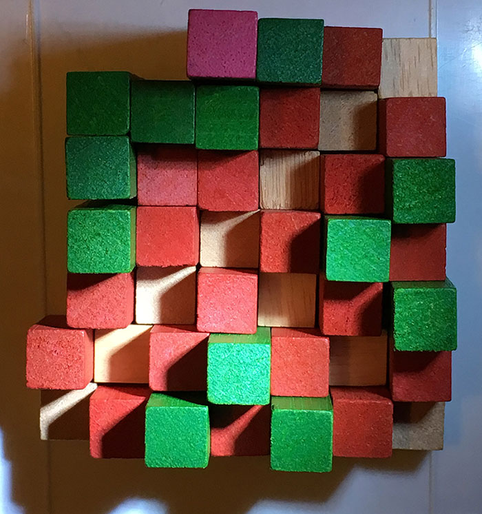 Playing with old wooden Cuisenaire rods - the colours were not helping at all!