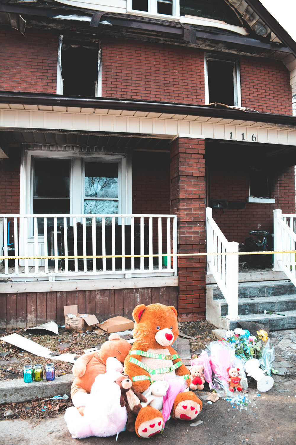 Outside the site of a house fire that left four people dead earlier this month in Oshawa.