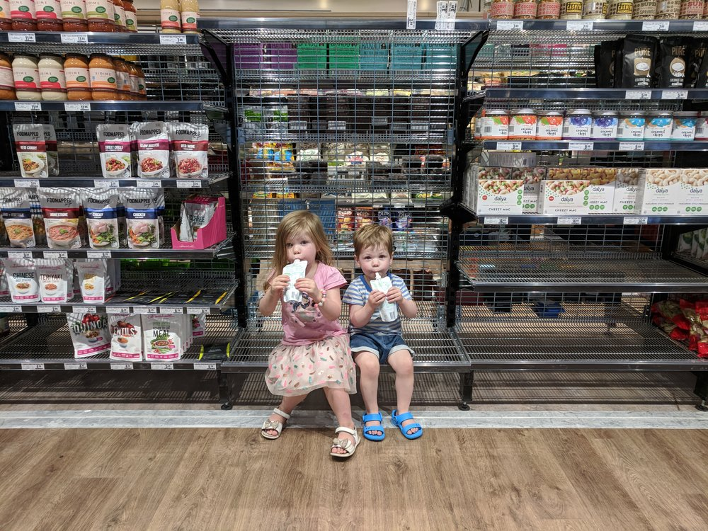4. Capture Your Every Day   Don't wait for the perfect time to pull out your camera. The perfect moment doesn't exist. It is our everyday, candid, unposed, real moments that will hold a special place in our hearts in years to come. This is one of my favourite snaps of my kids. Juggling kids with the weekly grocery shop is such a huge and often challenging part of our everyday life. Getting through it without a complete meltdown is total accomplishment, and the tactics I have employed to achieve this have been varied and often hilarious. This day, they basically ate their entire dinner at the supermarket on this empty shelf. It was as close to taking them to a restaurant as we would get!