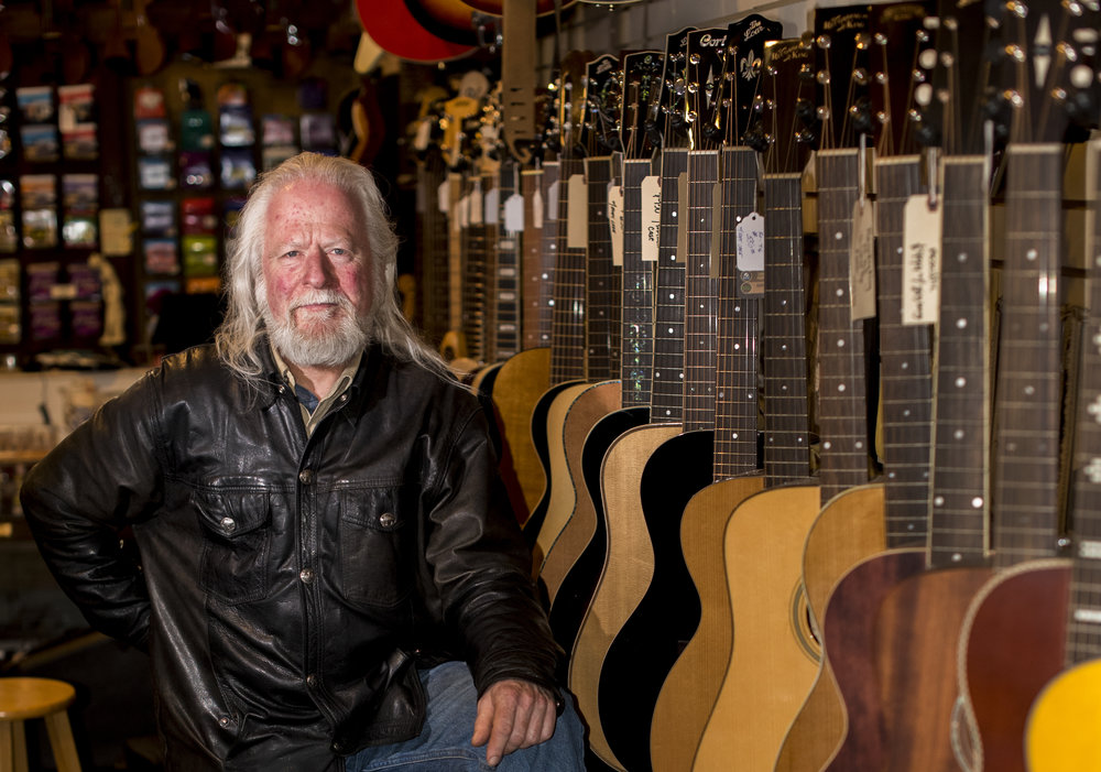 Frank McDermott sits in his shop, Blue Eagle Music, in Athens, Ohio