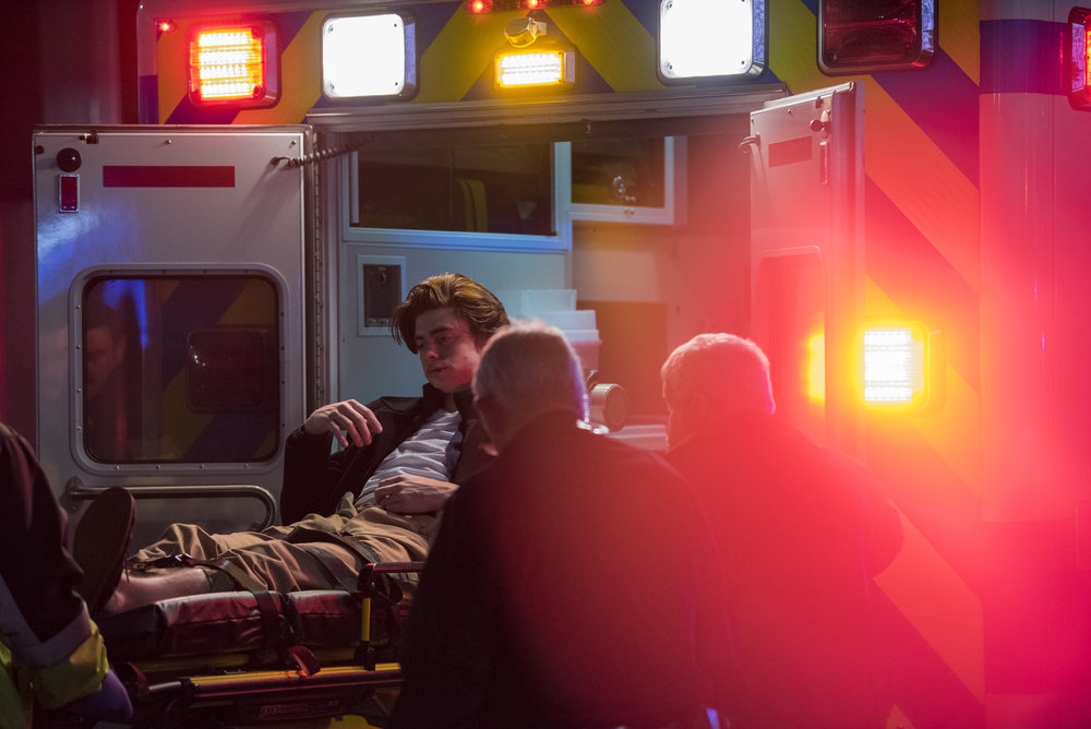 An Ohio University student (name excluded for privacy) is lifted into an Ambulance after he was found unconscious in a restaurant on Court Street in Athens, Ohio
