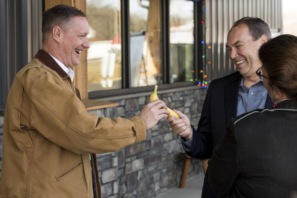 Rep. Steve Stivers and Sen. Bob Peterson share a laugh, as Stivers offers Peterson a banana he had just purchased at Campbell's Market.