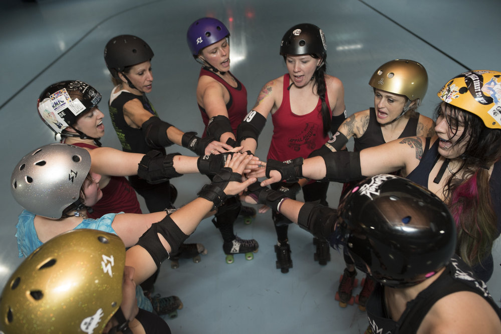 "The Appalachian Hellbetties do their signature ""Hell Yeah Hell Betties"" cheer to mark the end of practice."