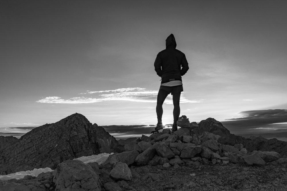 BW_Man ontop of Montain at daybreak pexels-photo-551852.jpg