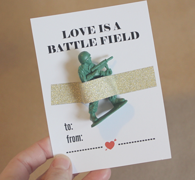 Grab the free printable  here  and a bag of army men  here .