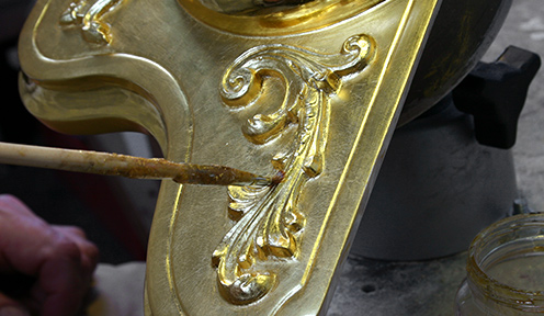 Photo: Applying shellac top coat on oil gilt gold leaf surface
