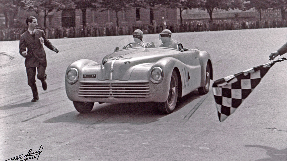 Photo:  1943 Alfa Romeo 6C 2500 Super Sport Cabriolet coming into the checkpoint at Florence during the 1948 Mille Miglia. Source: Archivio Foto Locchi Firenze, archival number 1948_L402-31.  www.fotolocchi.it