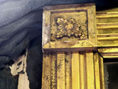 We had a large gilded frame that was crated after being wrapped in fabric moving pads. The crate was exposed to water and by the time the crate was opened, the pads were glued to large sections of the frame requiring that much of the frame had to be re-gilded.    The fibers of the blanket had caught sections of the rosette corner blocks and been pulled away from the substrate.