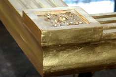 The gold leaf supplied by Wehrung & Billmeier Gold Leaf Company from Chicago, Illinois was applied to the areas of loss.