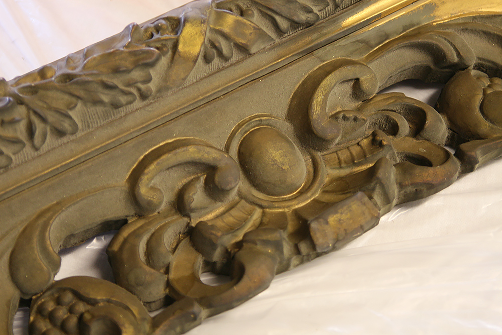 Photo:  Heavy bronze powder coating covering water gilded frame