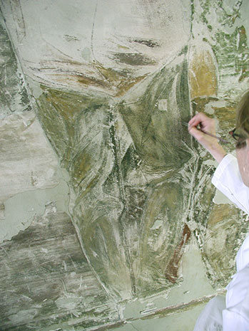 Photo:  Elizabeth Kendall examines the remnants of a failed fresco painted in 1936 by Frederico Lebrun
