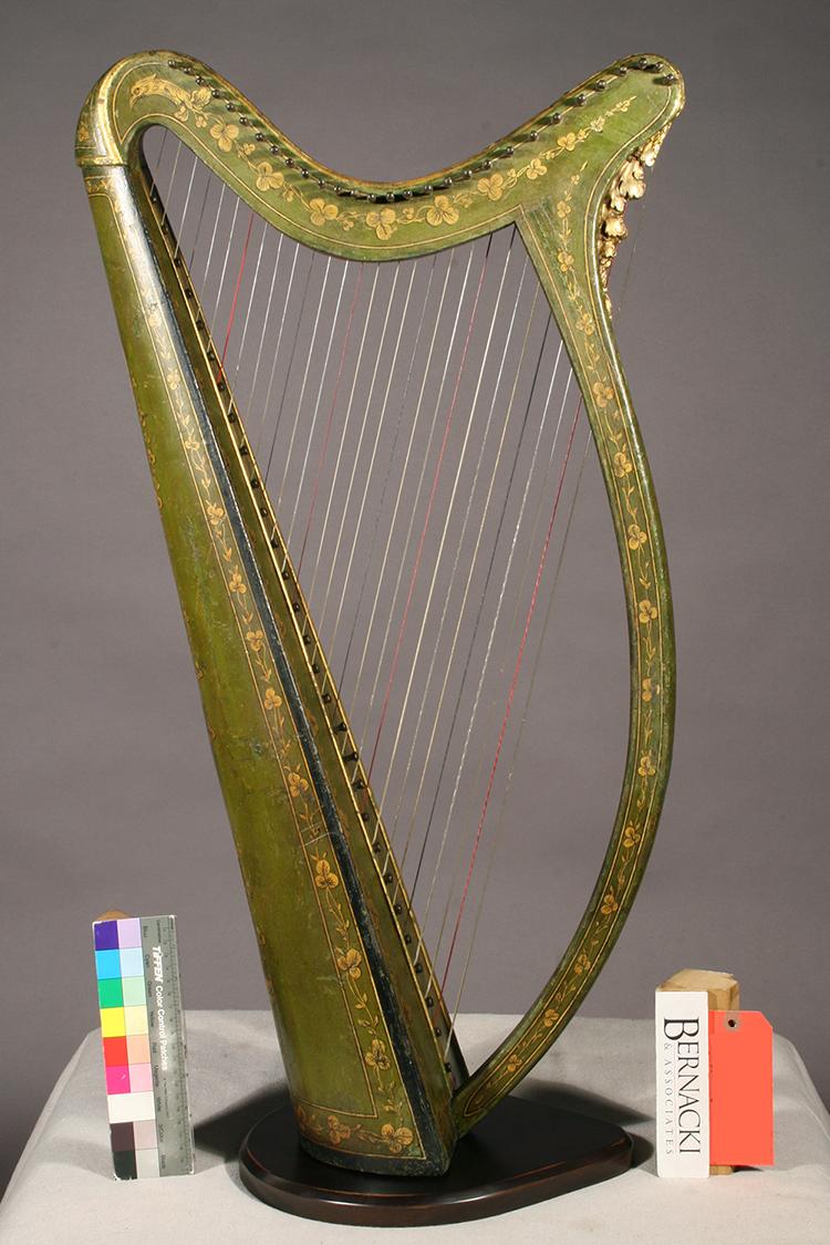 Historic Irish harp with polychrome details restored at Bernacki & Associates, Inc.