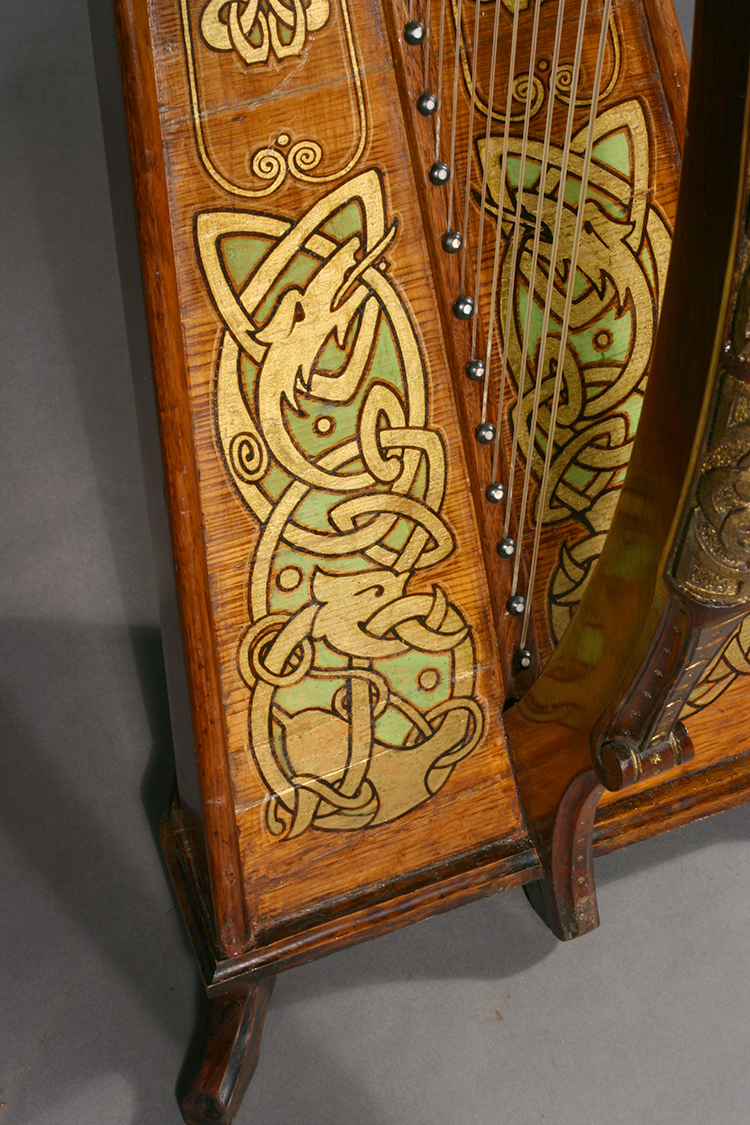 Polychrome and gilded decorations adorning James McFall harp