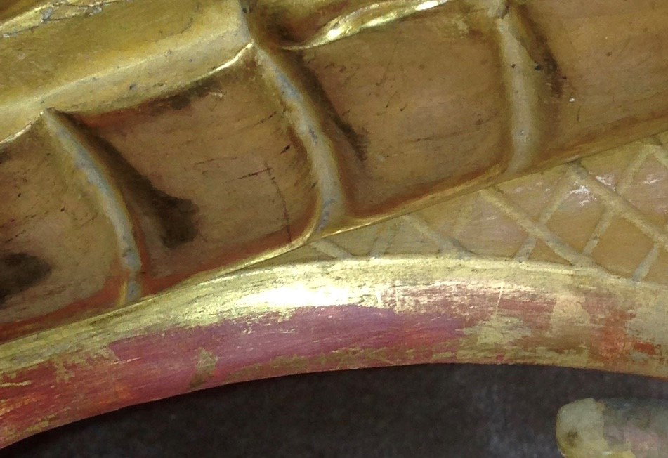 A section of gold leaf that has been accidentally removed from improper cleaning