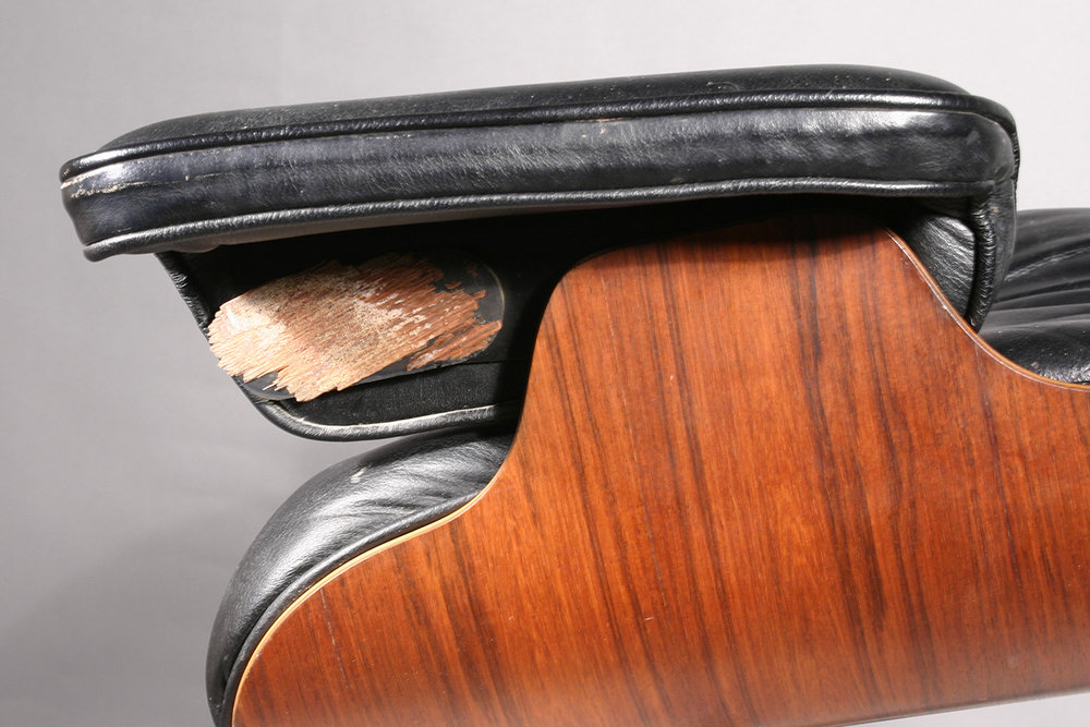 Eames chair damage: bent plywood separation at surface veneer layer