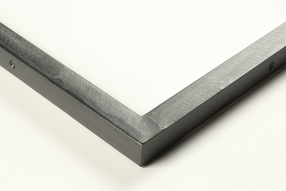 "Detail of a 0.75'"" wide molding steel frame with ground gunmetal"