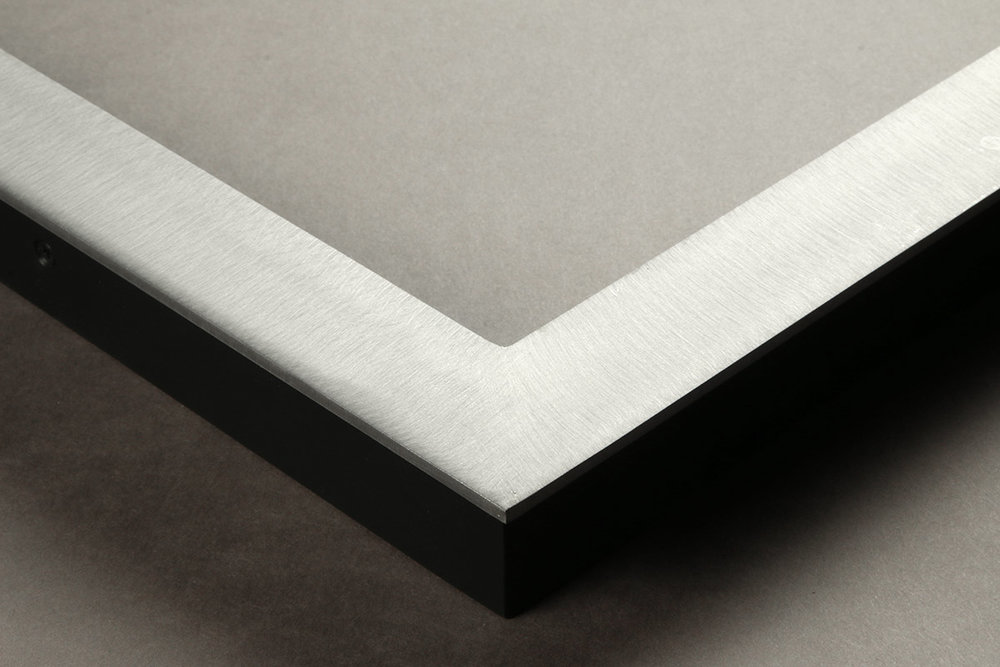 """Detail of an 1.25"""" wide molding steel frame with brushed satin finish"""
