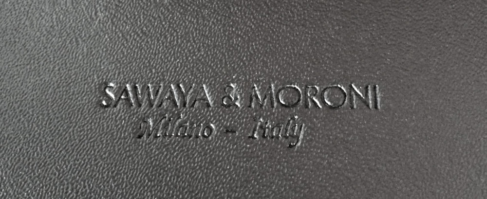 Sawaya & Moroni blind impression on the underside of the upholstered seat
