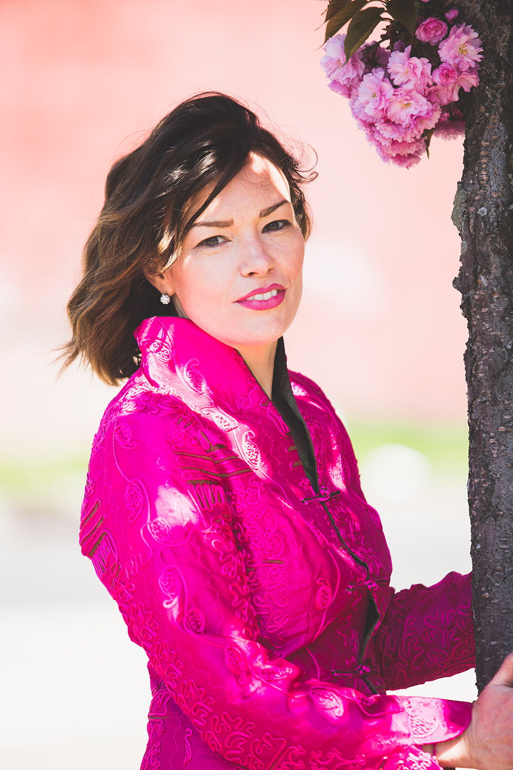 Nancy Byrne by tree in pink jacket