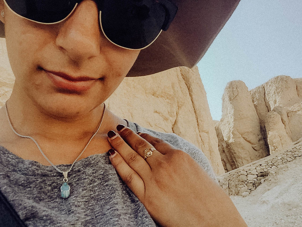 This is me at the Valley of the kings showing off my Scarab ring and necklace. Told you I went a little crazy lol -