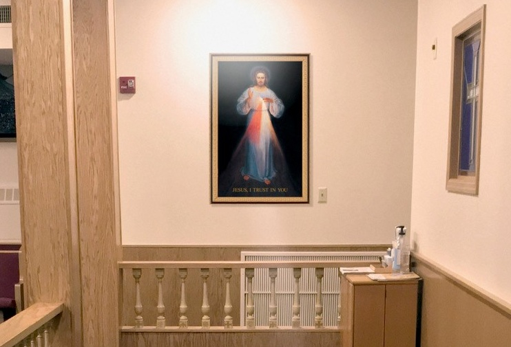 Framed Divine Mercy image near confessional concept