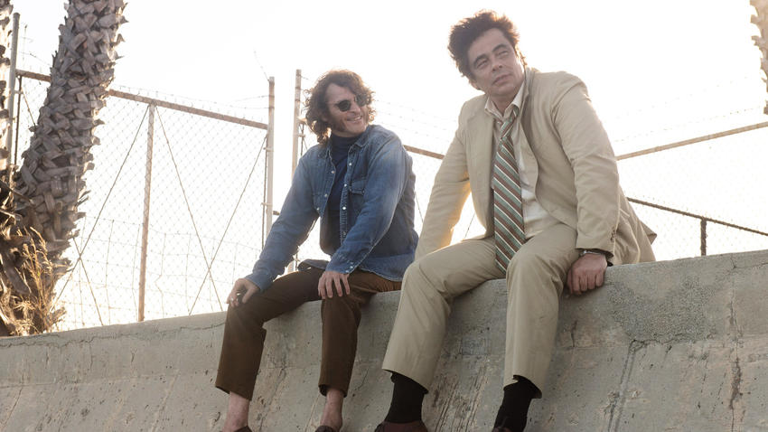 "Joaquin Phoenix, left, and Benicio Del Toro in ""Inherent Vice."" (photo credit: Wilson Webb / Warner Bros)"