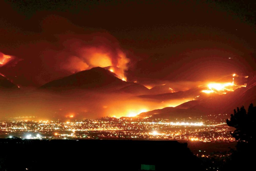 Northeastern San Bernardino, California, as the wildfires light up the night sky (photo courtesy of Chris Doolittle).