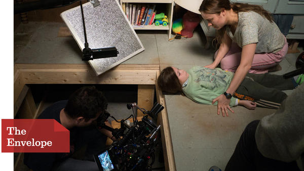"The titular space of ""Room"" was built with removable tiles so cameras could peek in to film young actor Jacob Tremblay and Brie Larson's scenes without being obtrusive. (George Kraychyk / A24)"